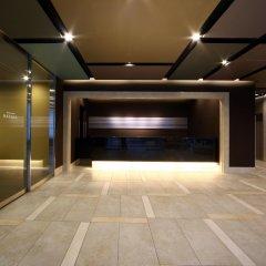Отель Dormy Inn Premium Hakata Canal City Mae парковка
