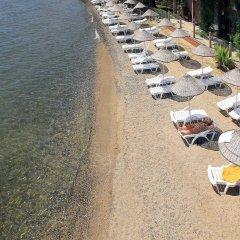 Marmaris Resort & Spa Hotel Турция, Кумлюбюк - отзывы, цены и фото номеров - забронировать отель Marmaris Resort & Spa Hotel онлайн пляж