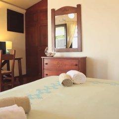 Отель Arbatax Park Resort Borgo Cala Moresca сейф в номере