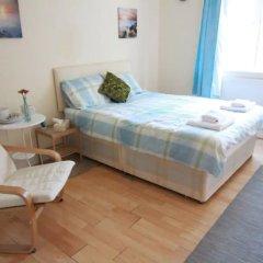 Апартаменты 4 Bedroom Apartment in Kilburn With Private Balcony комната для гостей фото 2