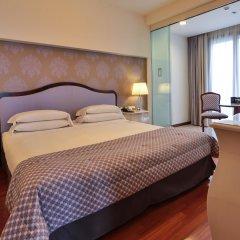 Отель UNAHOTELS Expo Fiera Milano Италия, Милан - отзывы, цены и фото номеров - забронировать отель UNAHOTELS Expo Fiera Milano онлайн комната для гостей фото 2