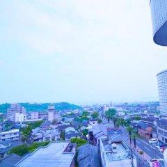 Отель Tsurumi Япония, Беппу - отзывы, цены и фото номеров - забронировать отель Tsurumi онлайн балкон