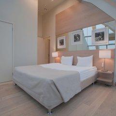 Апартаменты Arbat House Apartments on Bolshaya Nikitskaya комната для гостей фото 5