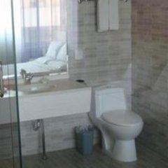 Отель Friendship Inn Tianjin International Exhibition Center ванная фото 2