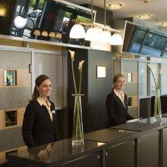 Отель NH Danube City Австрия, Вена - отзывы, цены и фото номеров - забронировать отель NH Danube City онлайн интерьер отеля фото 2
