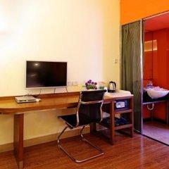 Отель Gangding Garden Inn удобства в номере