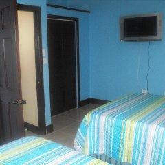 Отель Tropik Leadonna Ямайка, Монтего-Бей - отзывы, цены и фото номеров - забронировать отель Tropik Leadonna онлайн удобства в номере фото 2