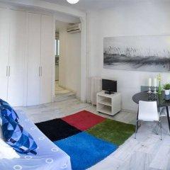 Отель Apartamentos Puerta Del Sol - Plaza Mayor Испания, Мадрид - отзывы, цены и фото номеров - забронировать отель Apartamentos Puerta Del Sol - Plaza Mayor онлайн комната для гостей