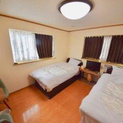 Отель Arimaonsen Musubi-no-koyado En Кобе комната для гостей фото 3