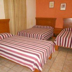 Отель Posada Garibaldi Мексика, Гвадалахара - отзывы, цены и фото номеров - забронировать отель Posada Garibaldi онлайн комната для гостей фото 5