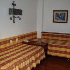 Отель Apartamentos Bajondillo Испания, Торремолинос - отзывы, цены и фото номеров - забронировать отель Apartamentos Bajondillo онлайн комната для гостей фото 2
