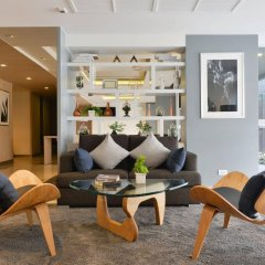 Отель The Grass Serviced Suites by At Mind интерьер отеля фото 3