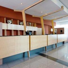 Отель NH Leipzig Messe интерьер отеля
