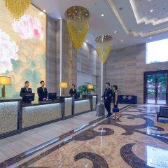 Отель Yimin Gold Olives Apartment Китай, Шэньчжэнь - отзывы, цены и фото номеров - забронировать отель Yimin Gold Olives Apartment онлайн интерьер отеля