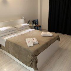 Отель Tiburtina Suites комната для гостей