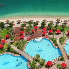 Отель Khalidiya Palace Rayhaan by Rotana, Abu Dhabi пляж фото 2