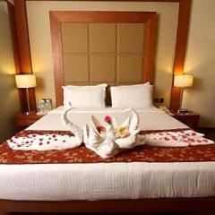 Отель Cambay Grand в номере фото 2