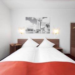 Отель McDreams Hotel Leipzig Германия, Плагвиц - отзывы, цены и фото номеров - забронировать отель McDreams Hotel Leipzig онлайн комната для гостей фото 4