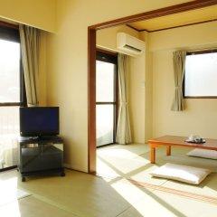 Condominium Hotel Garland Court Usami Ито комната для гостей фото 4