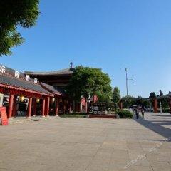 Отель Tangzonglong Hotel (Xi'an Qujiang Big Wild Goose Pagoda North Square Music Fountain) Китай, Сиань - отзывы, цены и фото номеров - забронировать отель Tangzonglong Hotel (Xi'an Qujiang Big Wild Goose Pagoda North Square Music Fountain) онлайн парковка