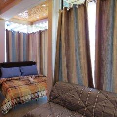 Отель Alon Travelers Lodge Филиппины, Пуэрто-Принцеса - отзывы, цены и фото номеров - забронировать отель Alon Travelers Lodge онлайн комната для гостей фото 4