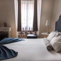 Отель Lisbon Arsenal Suites Лиссабон комната для гостей фото 3