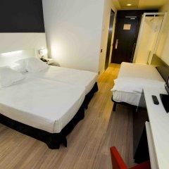 Отель Axor Feria комната для гостей