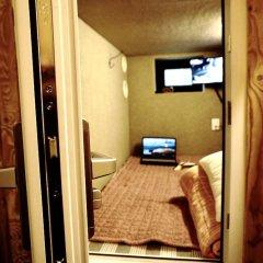 Отель Capsule Majung сейф в номере