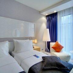 Radisson, Роза Хутор (Radisson Hotel, Rosa Khutor) комната для гостей фото 5