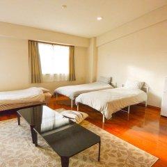 Отель Resort Mansion SeaZone Центр Окинавы комната для гостей