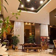 Отель Overseas Capital Hotel Китай, Джиангме - отзывы, цены и фото номеров - забронировать отель Overseas Capital Hotel онлайн интерьер отеля фото 2