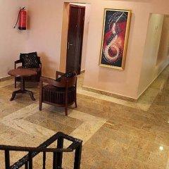 Отель Adsuit Hotel Нигерия, Калабар - отзывы, цены и фото номеров - забронировать отель Adsuit Hotel онлайн интерьер отеля