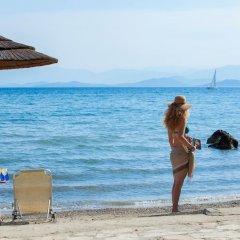 Отель TUI Family Life Kerkyra Golf Греция, Корфу - отзывы, цены и фото номеров - забронировать отель TUI Family Life Kerkyra Golf онлайн пляж фото 2