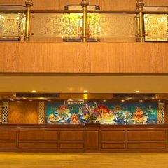 Отель MONTIEN Бангкок фитнесс-зал фото 2