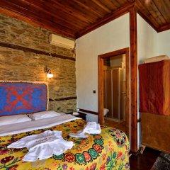 Отель Sihirbazin Evi сейф в номере