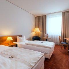 Отель NOVINA HOTEL Südwestpark Nürnberg Германия, Нюрнберг - 1 отзыв об отеле, цены и фото номеров - забронировать отель NOVINA HOTEL Südwestpark Nürnberg онлайн комната для гостей