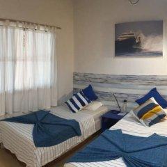 Отель Thulusdhoo Surf Camp Остров Гасфинолу комната для гостей фото 4