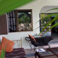 Отель Pride Garden Hotel Нигерия, Калабар - отзывы, цены и фото номеров - забронировать отель Pride Garden Hotel онлайн интерьер отеля