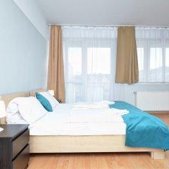 Апартаменты Agape Apartments комната для гостей фото 9