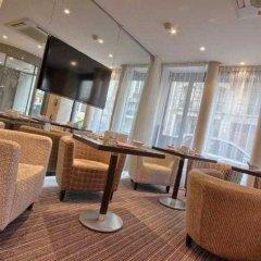 Отель Timhotel Opera Grands Magasins Париж интерьер отеля фото 2