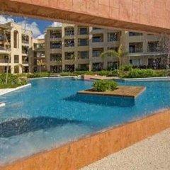 Отель Encanto El Faro Luxury Ocean Front Condo Hotel Мексика, Плая-дель-Кармен - отзывы, цены и фото номеров - забронировать отель Encanto El Faro Luxury Ocean Front Condo Hotel онлайн бассейн фото 2