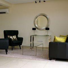 Отель New Brookfields Hotel Сьерра-Леоне, Фритаун - отзывы, цены и фото номеров - забронировать отель New Brookfields Hotel онлайн интерьер отеля фото 3