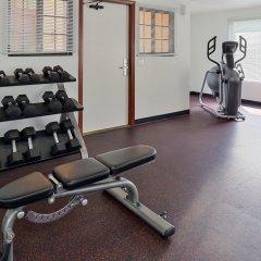 Отель Best Western Plus Raffles Inn & Suites фитнесс-зал фото 2