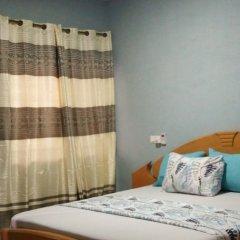 Отель Maybeth Guest House Гана, Кофоридуа - отзывы, цены и фото номеров - забронировать отель Maybeth Guest House онлайн комната для гостей