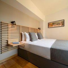 Отель Fos DownTown Suites Афины комната для гостей фото 3