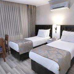 Monarch Hotel комната для гостей