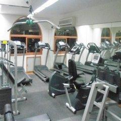 Отель Al Liwan Suites фитнесс-зал фото 4