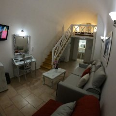 Отель Mathios Village Греция, Остров Санторини - отзывы, цены и фото номеров - забронировать отель Mathios Village онлайн интерьер отеля фото 2