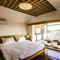 Отель Suzhou Tai Lake Pur-land Inn комната для гостей