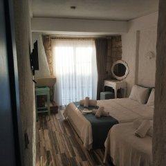 Отель Alacati Asmali Konak Otel Чешме комната для гостей фото 4